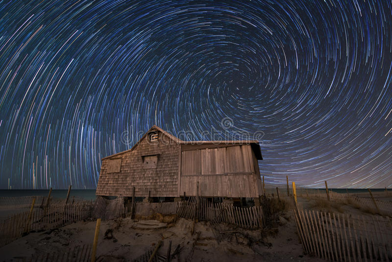Spiral Star Trails over an abandoned shack. Star trails over Judges Shack in Seaside New Jersey royalty free stock photography