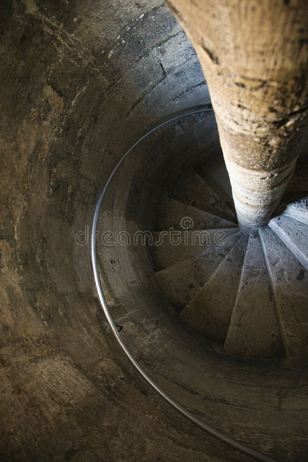 Spiral stone staircase. stock photos