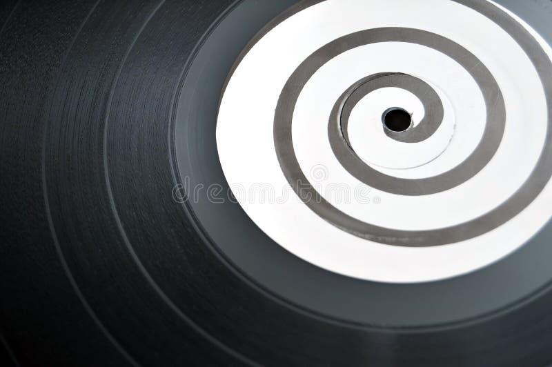Spiral Vinyl LP Music Record. Round circular vinyl lp music record with a spiral design in the middle stock photo
