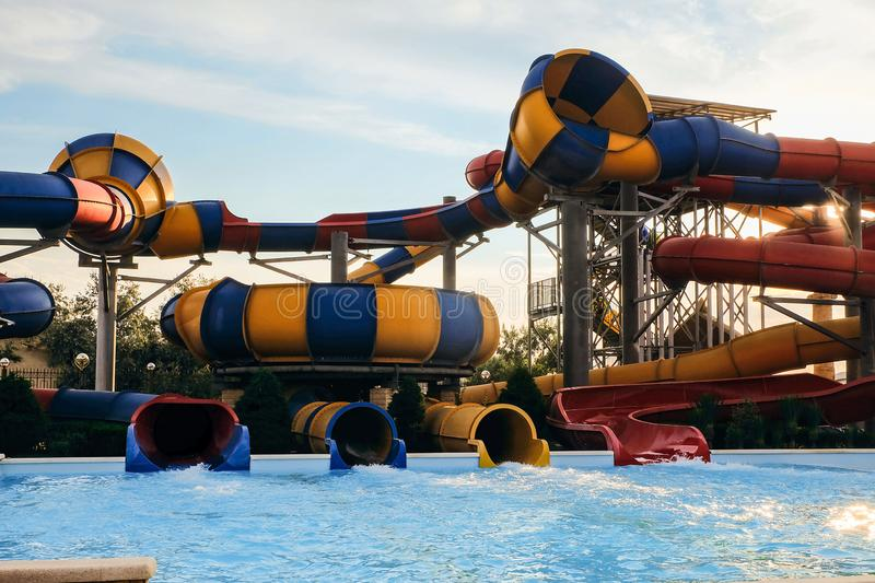 Spiral water slide in the outdoors seasonal aquapark stock images