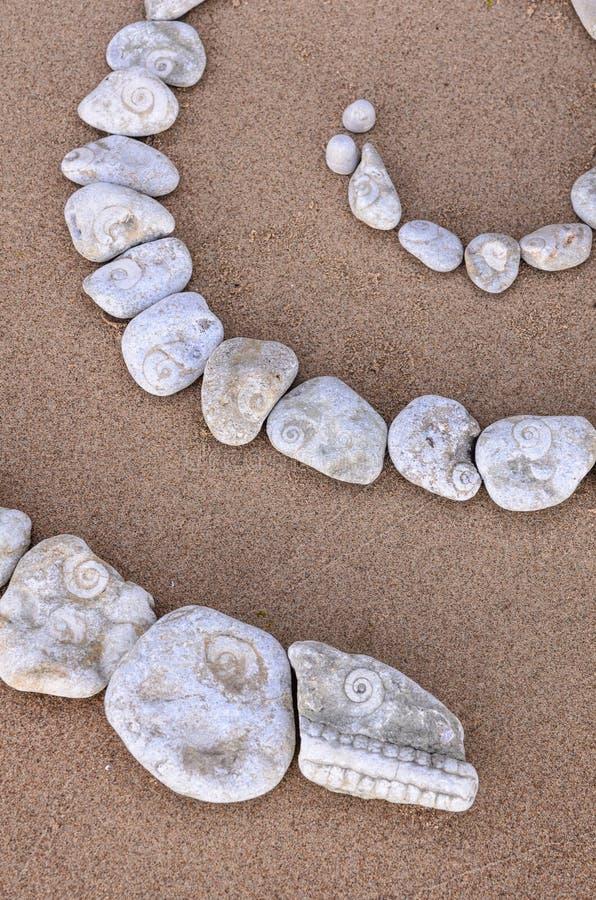 Spirale auf Sand stockbild