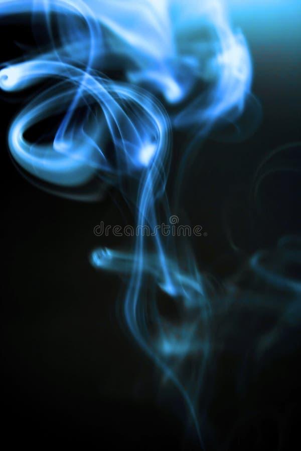 Spiralling Cigarette Smoke Royalty Free Stock Photo