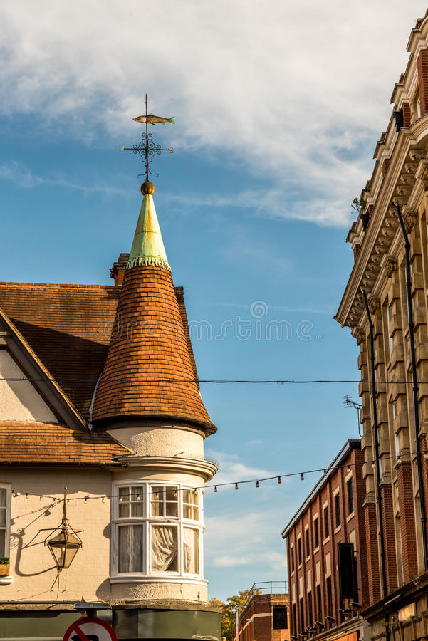 A Spire of the building in old English town.  stock photo