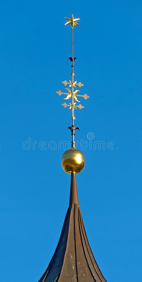 Spire with golden star. Of the St. Michael parish church, San Candido, South Tirol, Italy stock photo