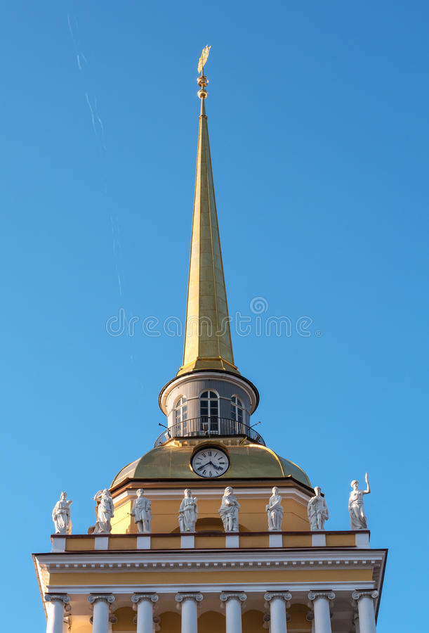The spire of the Main Admiralty in St. Petersburg. The spire is decorated with columns, statues and clocks stock photos