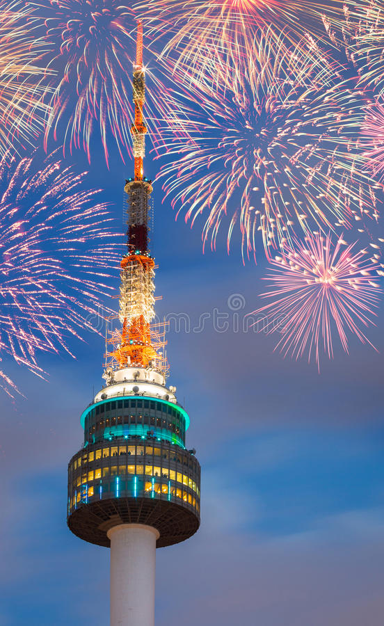 The spire of N Seoul Tower with Fireworks. South Korea stock photo