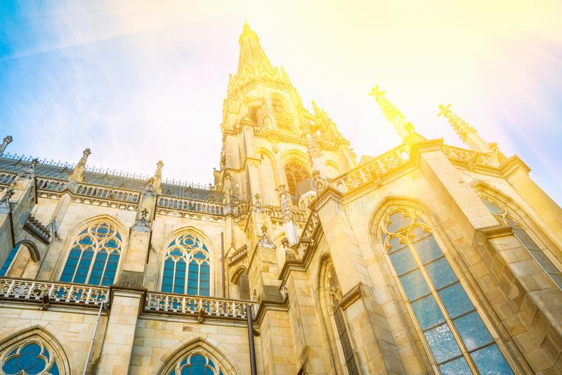 Spire of the New Dome gothic cathedral in Linz Austria. Low angle perspective. Blue sky golden sunlight. Close up. Of architectural details. Copy space royalty free stock image