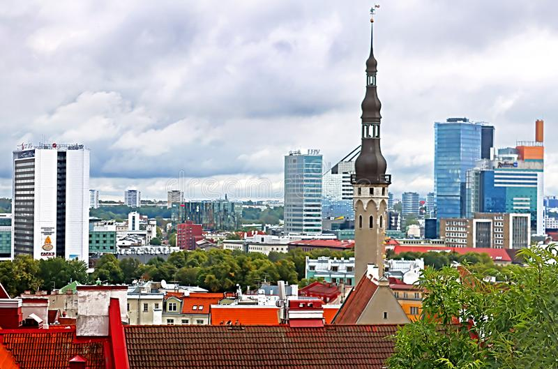 The spire of the old town hall on the background of modern buildings in Tallinn, Estonia. Baltic countries stock image