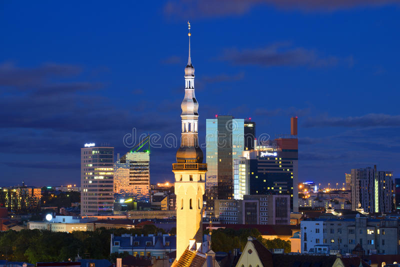 The spire of the old town hall on the background of the modern city. Tallinn, Estonia stock image