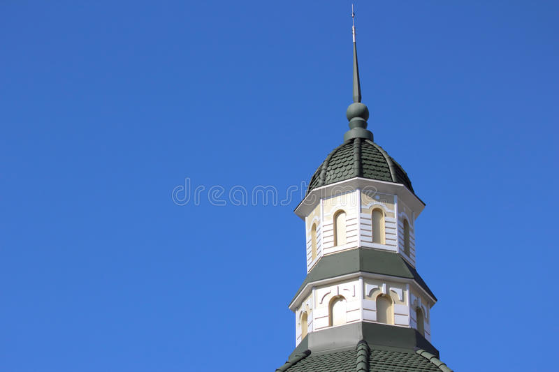 Spire of the tower against the sky. The spire of the tower against the sky royalty free stock photos