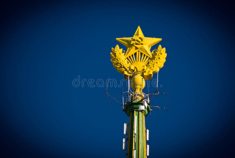 Spire tower building in cloudless blue sky. Spire tower building in the cloudless blue sky royalty free stock photos