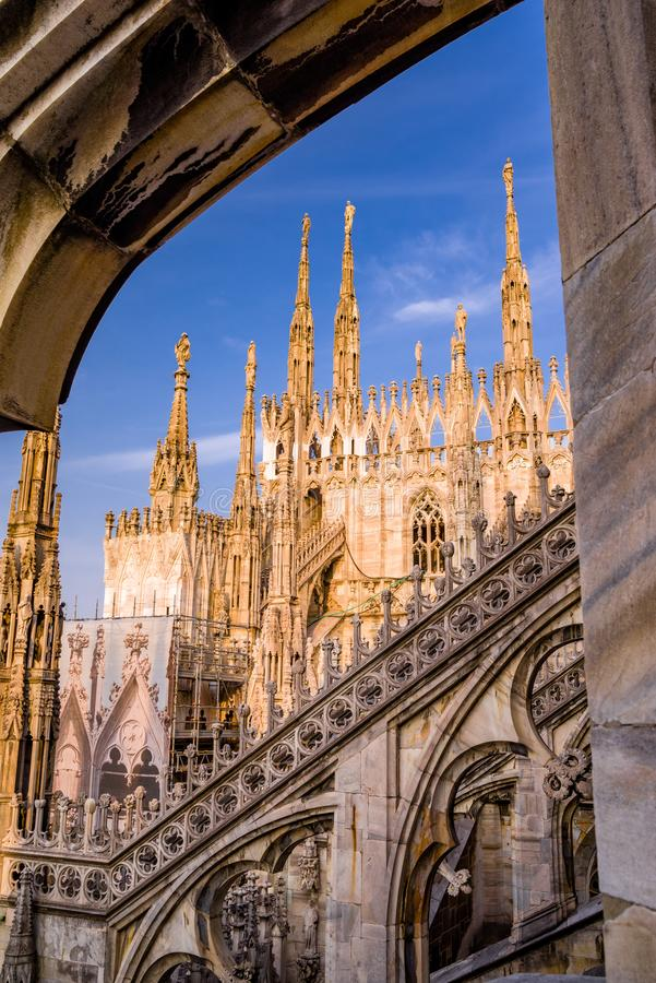 The spires of the Duomo di Milano glow as sunset approaches. stock image