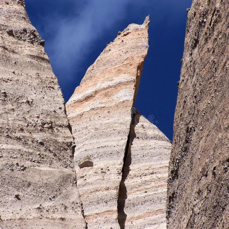 Spires of layered stone from ancient volcanic ash against the blue sky stock photo