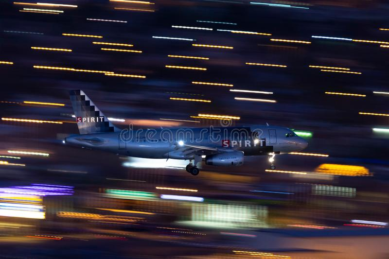 Spirit Airlines Airbus A319 regional airliner on approach to land at McCarran International Airport in Las Vegas at night. Las Vegas, Nevada, USA - May 5, 2013 stock photo