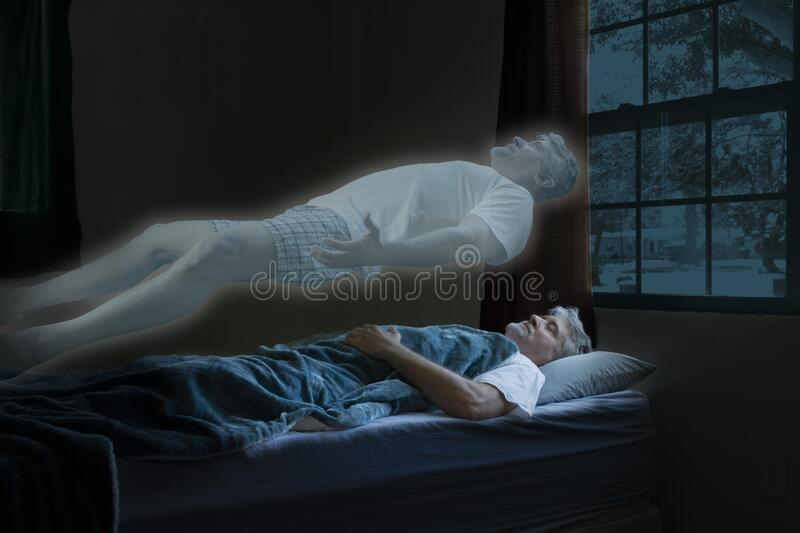 Spirit or angel leaving body of a dead man who has died in his sleep as it floats above him ascending into heaven. Glowing spirit or angel leaving body of a dead stock images