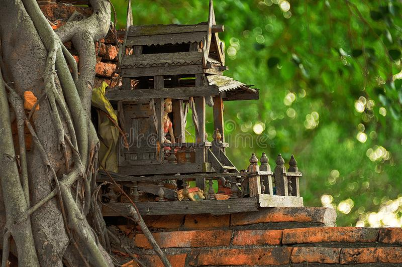 SPIRIT HOUSE AND TREE ROOTS INTERTWINED. royalty free stock photos