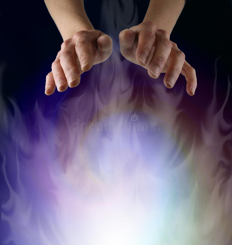 Spirit Matter. Female hands hovering over a misty ethereal energy field stock photos