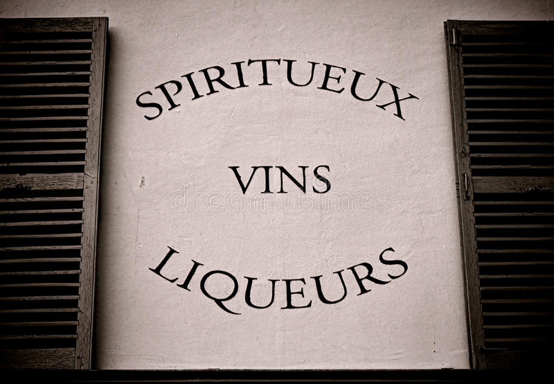 Spirits Wine and Liquor Store French Sign on Wall stock photo