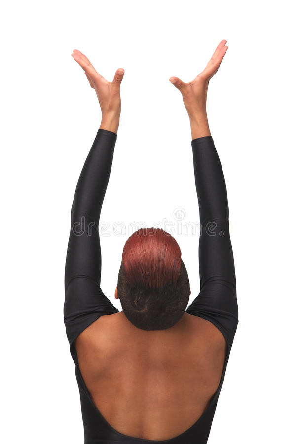 Spiritual African American Beauty. Spiritual portrait of an African American woman with hands up to the heavens. meditation and serenity in an elegant pose from royalty free stock photography