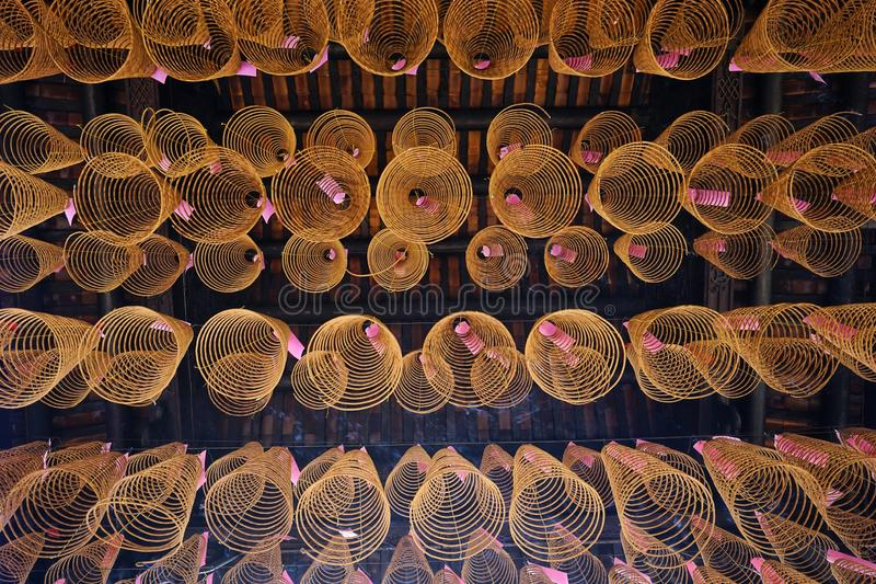 Spiritual atmosphere in a chinese pagoda in new year. A popular tradition for asia people to burn incense and round incense sticking with their prayers of good stock photography