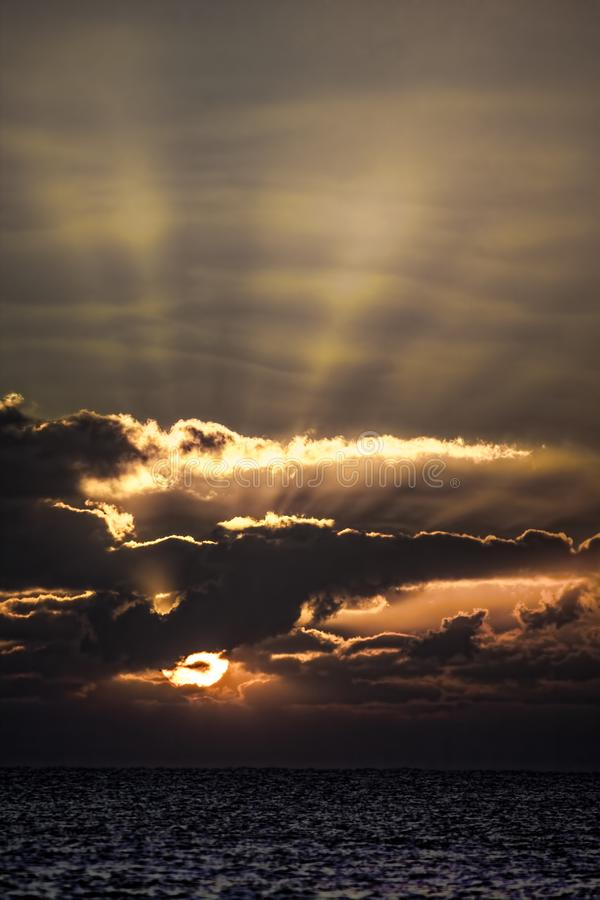 Spiritual awakening. Dramatic sunrise representing the creation. Of heaven and earth. Dawn over the ocean horizon. Picturesque aesthetic image of sun rising stock photo