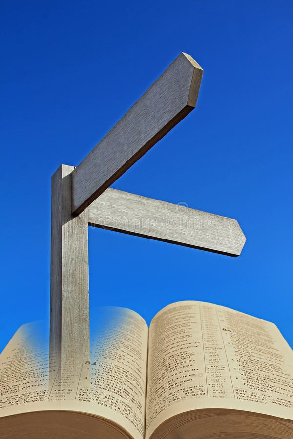 Spiritual bible direction path divine faith open holy book. Concept photo of open holy bible book with direction arrow sign depicting path to spiritual light stock photos