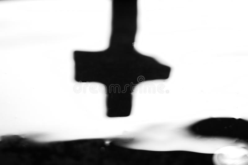Spiritual concept with blurred black cross stock photography