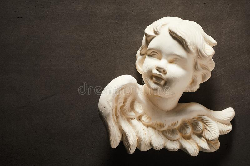 Spiritual concept with figurine of angel royalty free stock photo