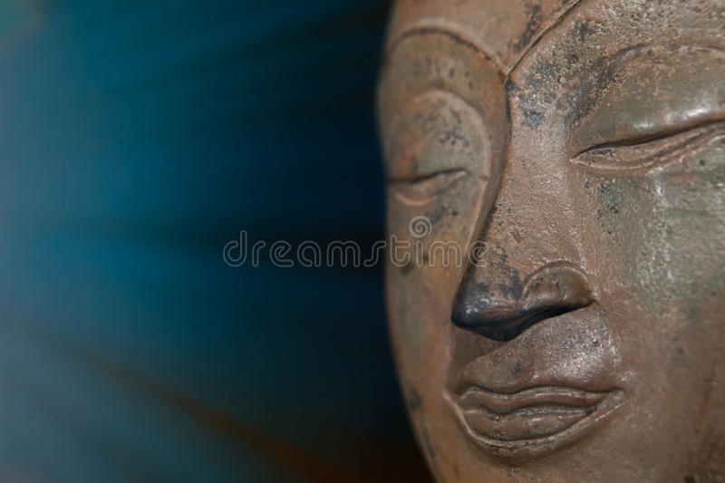 Spiritual enlightenment and mindfulness. Mindful buddha meditating with calm expression. stock image