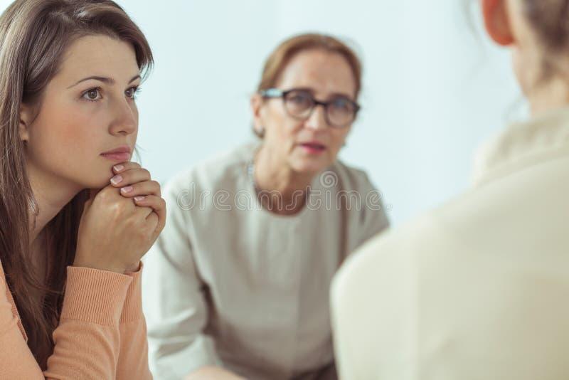 Spiritual guide talking with women royalty free stock photos