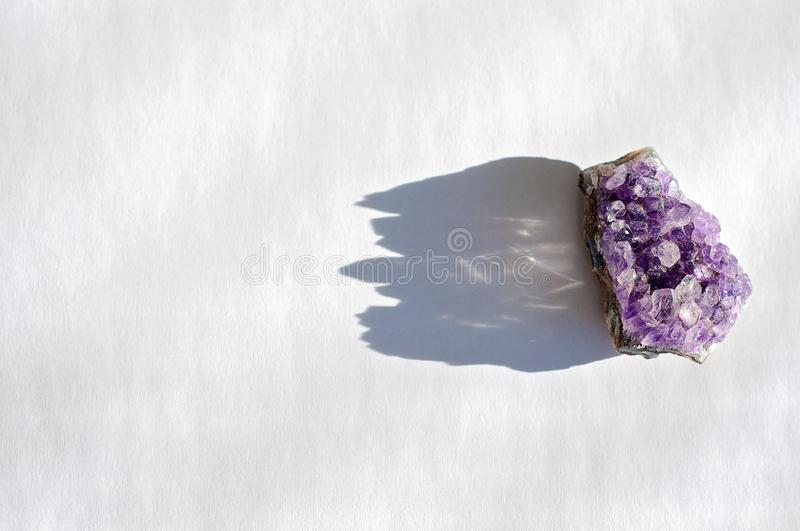 Spiritual healing amethyst crystal or gemstone is used to uplift intuition, to bring good energy and positive vibrations along stock image