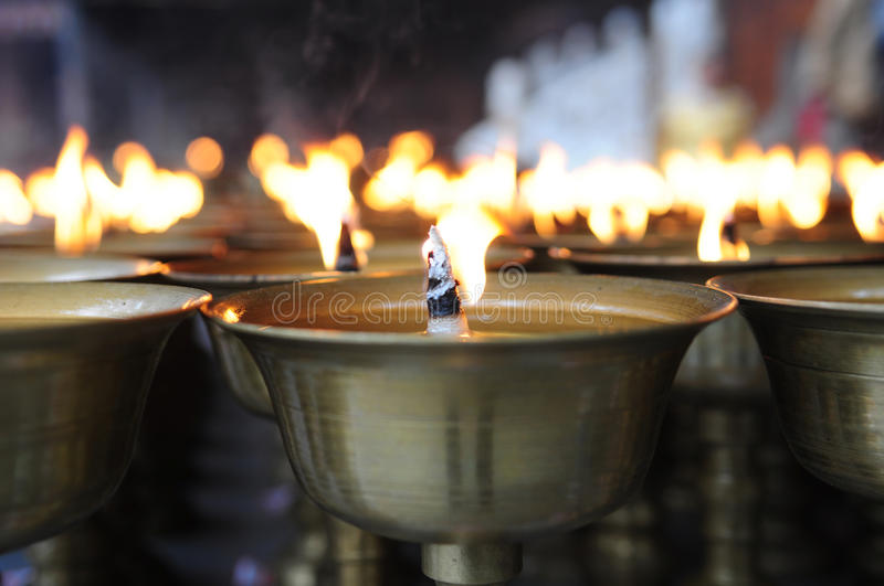 Spiritual oil lamps in temple stock images