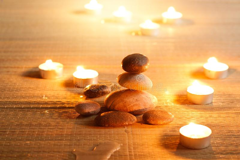 Spiritual purity atmosphere with oil lamps in temple. Stone bala royalty free stock photo