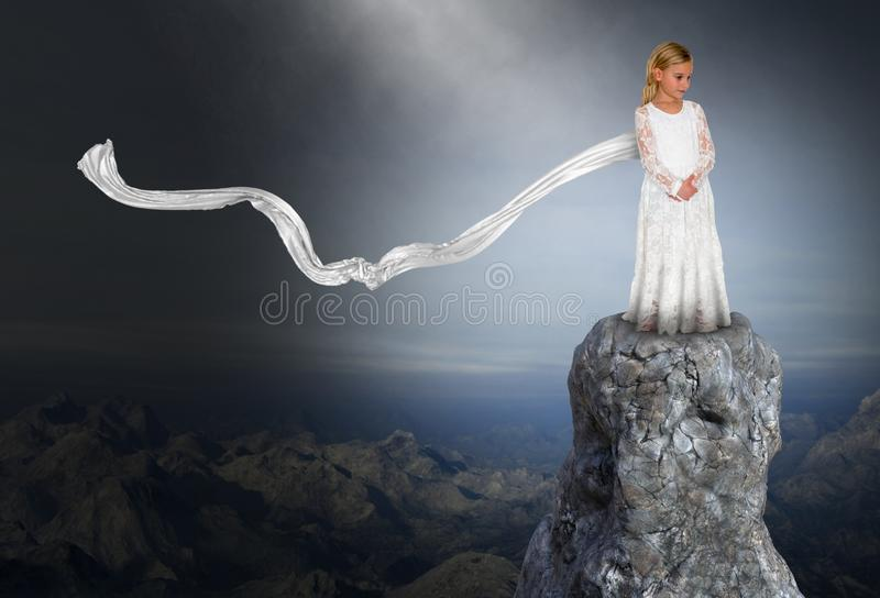 Spiritual Rebirth, Peace, Hope, Love, Nature, Girl. A young girl stands in a surreal mountain landscape and uses her imagination to look at the future. Abstract stock photo