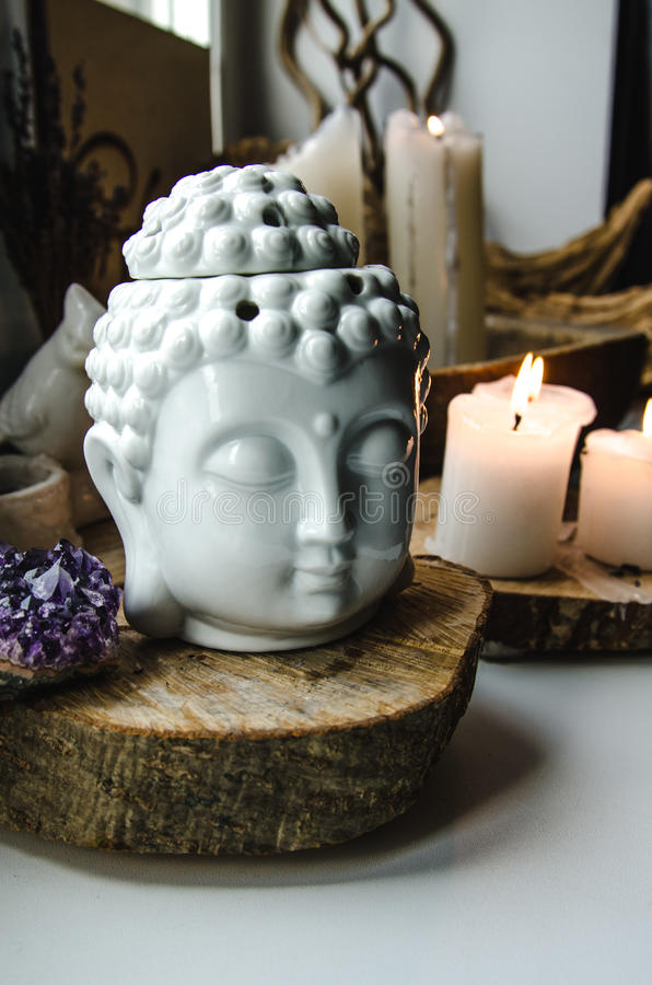 Spiritual ritual meditation face of Buddha ametist candles on old wooden background. Spiritual ritual meditating face of Buddha ametist candles on old wooden royalty free stock photos