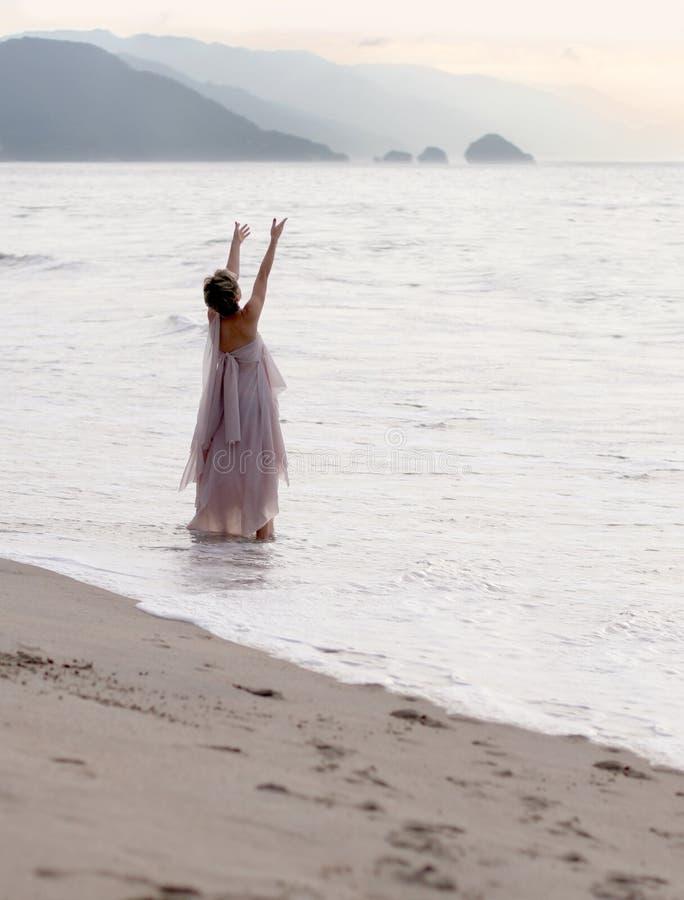 Spiritual woman. On the beach stock image