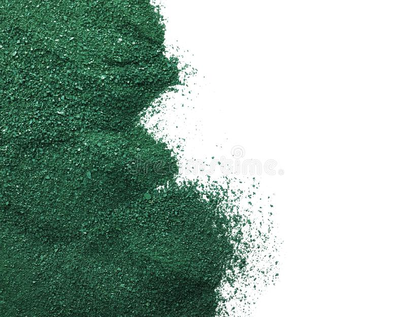 Spirulina algae powder on white background, top view with space. For text royalty free illustration