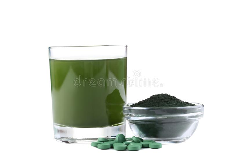 Spirulina drink and tablets royalty free stock photos