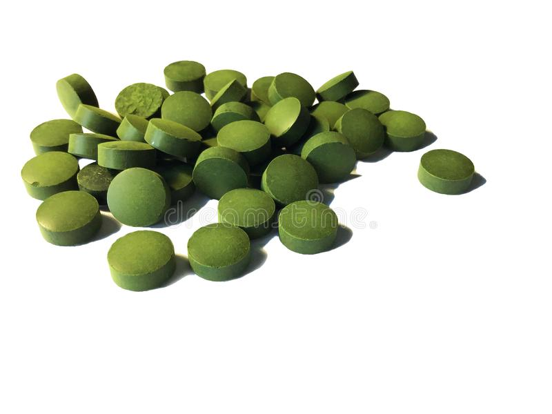 Spirulina ou comprimés de chlorella image stock