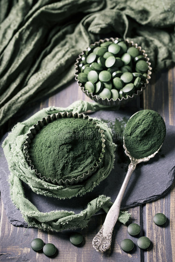 Spirulina pills and powder stock images