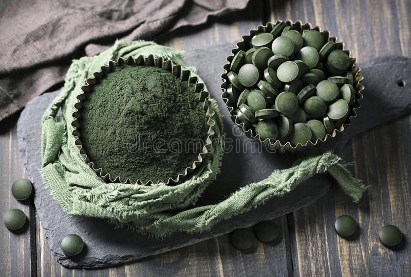 Spirulina tablets and powder stock image