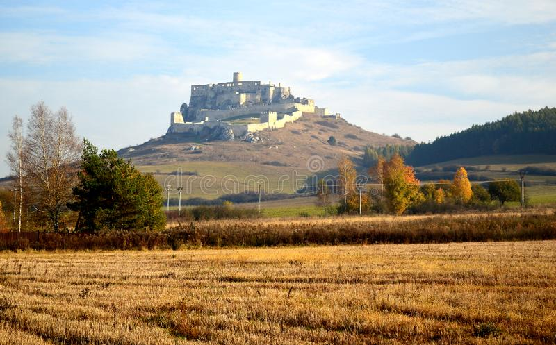Spis Castle Spišský hrad Exterior view from across the golden fields. The ruins of Spiš Castle in eastern Slovakia form one of the largest castle sites stock photography