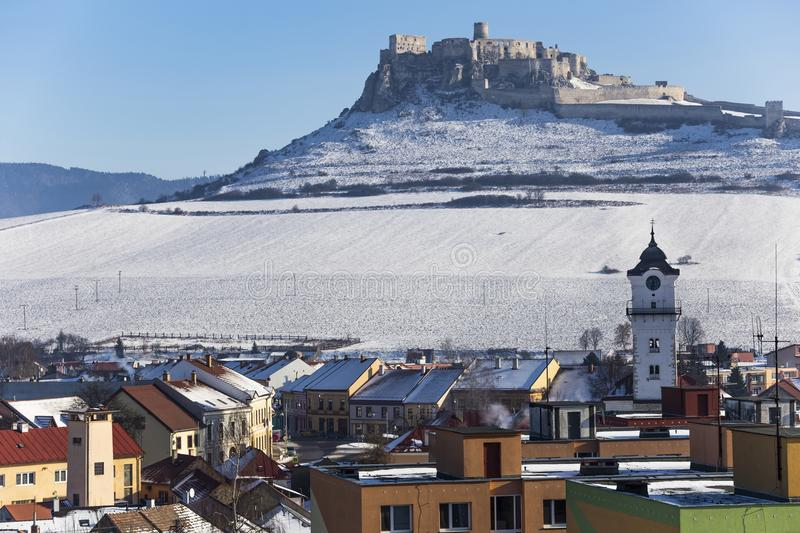 Spis Castle and Spisske Podhradie, Slovakia. View of the snow-covered Spis Castle Spissky hrad , the largest castle in Slovakia from the town of Spisske stock images