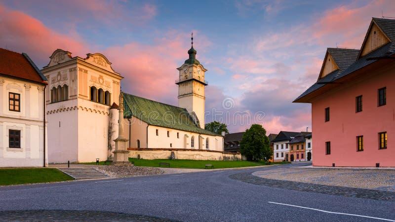 Spisska Sobota, Slovakia. Church and a Renaissance bell tower in the main square of Spisska Sobota in Poprad royalty free stock photography