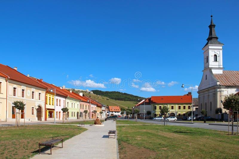 Spisske Podhradie, Slovakia. Central street of Spisske Podhradie town and Spis Castle Spissky hrad on the hill, Slovakia stock image