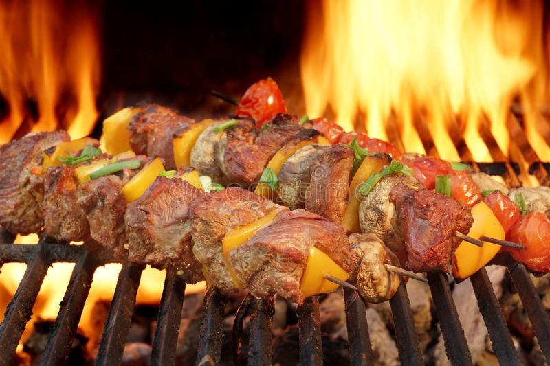 Spit Roast Beef Kebabs On The Hot Flaming BBQ Grill. Close-up stock images