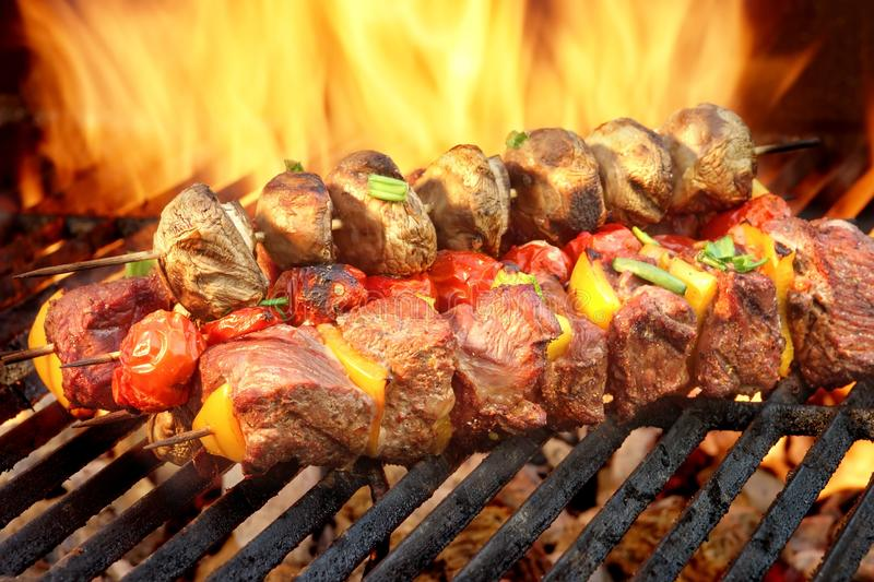 Spit Roast Beef Kebabs On The Hot Flaming BBQ Grill. Close-up royalty free stock photo