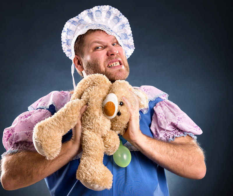 Spiteful man with teddy bear royalty free stock photography