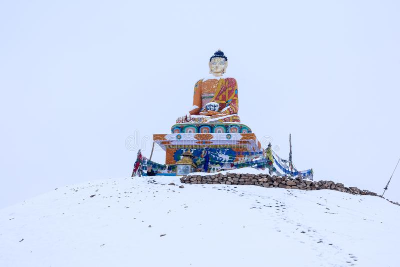 Buddha - Snow Covered Langza Village, Spiti Valley, Himachal Pradesh. The Spiti Valley is a cold desert mountain valley located high in the Himalaya mountains in royalty free stock photo