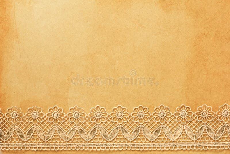 Spitze auf altem Papier lizenzfreies stockbild